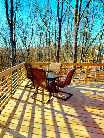 Canopy Ridge yurt table on deck